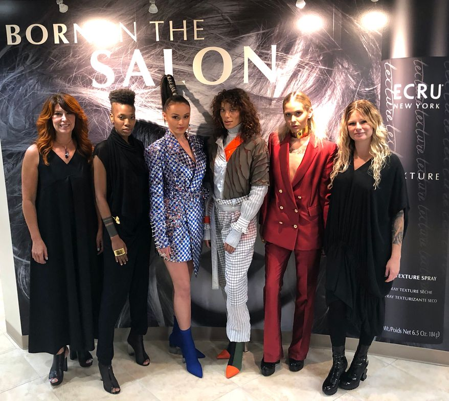 <strong>Lisa Lobosco and Amanda Jenkins flank models at the grand opening of the Ecru New York Academy.</strong>