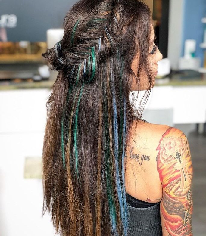 """In showing off these colors, Crews reminded her follows """"sometimes your extensions don't have to match your hair."""""""