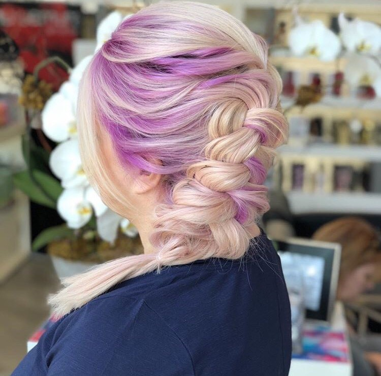 "With this fun, colorful braid, Crews reminded her followers ""Just because you have hair extensions doesn't mean you can't wear fun colors or pull your hair back into ponytails and braids."""