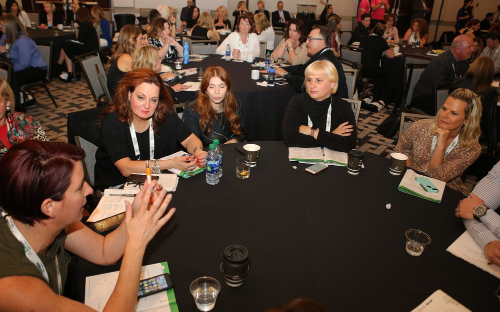 <p>Attendees discuss a question posed by the Culture Panel.</p>