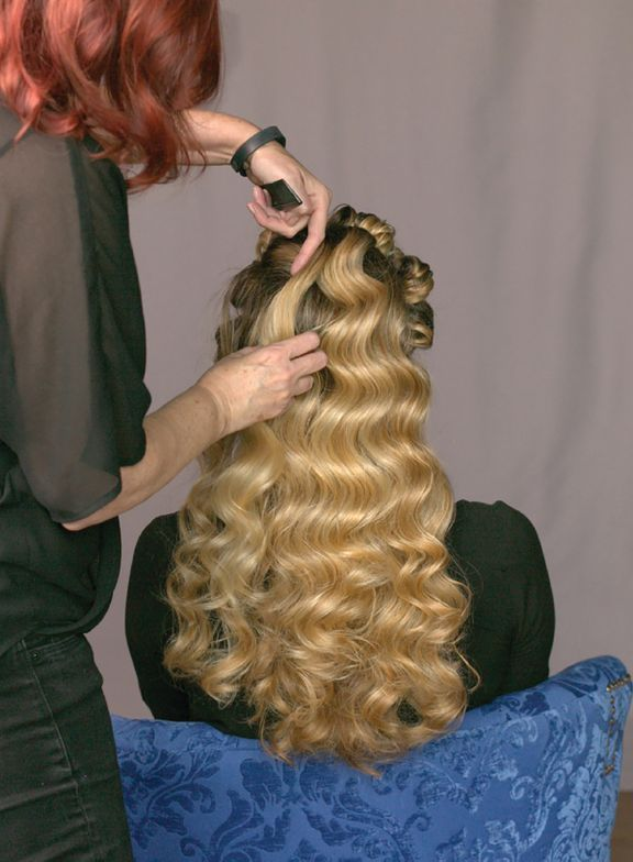 3. Beginning at the nape, release one curl at a time and spread it horizontally without disturbing the wave pattern. Continue spreading curls into the crown, the sides and, last, the front.
