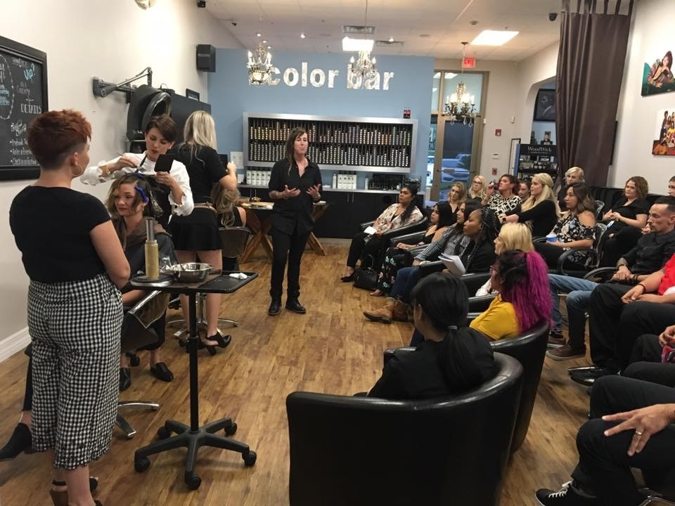 Taelor Pleas welcomes local cosmetology schools to a demonstration during Cutting Loose's Social Hour.