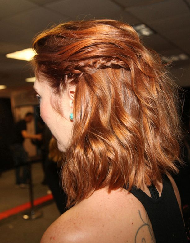 Aveda hairstylist, Ashley Goodwin, a rich redhead with a terrific textured lob and one chic braid to one side, backstage at the Leann Marshall Show.<br />Photo: Helen Oppenheim