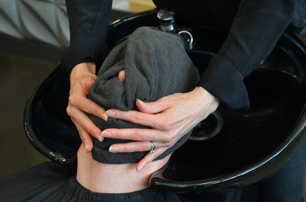 A mini facial at the shampoo bowl is an ideal time to discuss skin care with male clients.