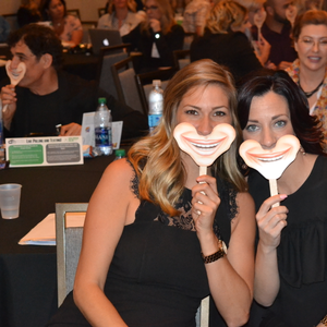 Attendees don the smiling signs that the Westerbekes gave out as a reminder of how important a...