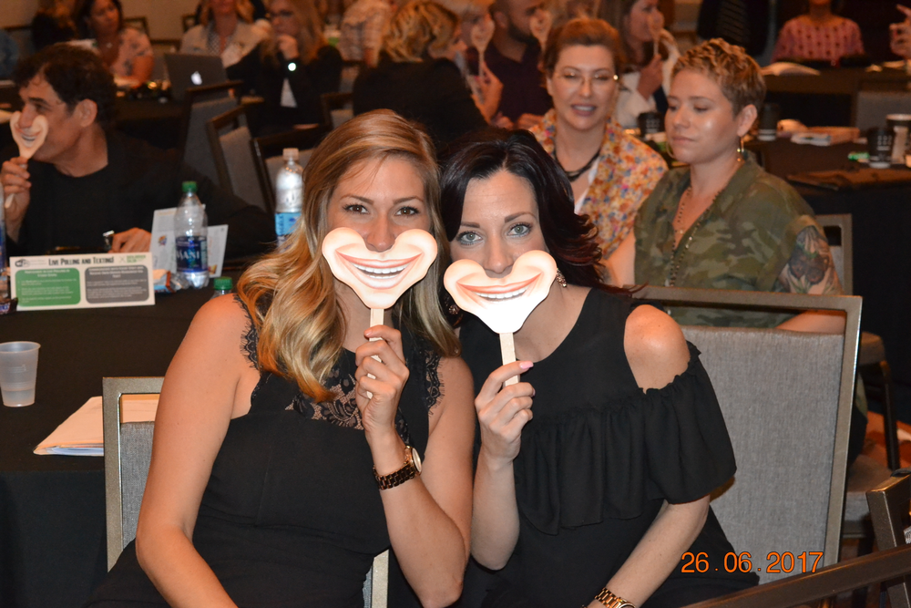 Attendees wearing their smiles that were provided by the Westerbekes.