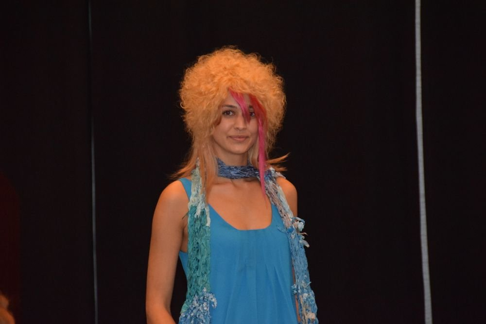 An Evolve model showcases the brand's colorful Lollipop extensions during its track-two presentation.