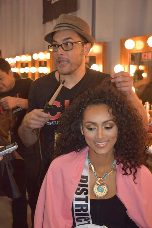 Albert Luiz styles Kara McCullough's curls backstage before she won the title of Miss USA.