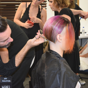Stylist Jay Ralston puts the finishing touches on a precision cut before the B.I.G. Show.