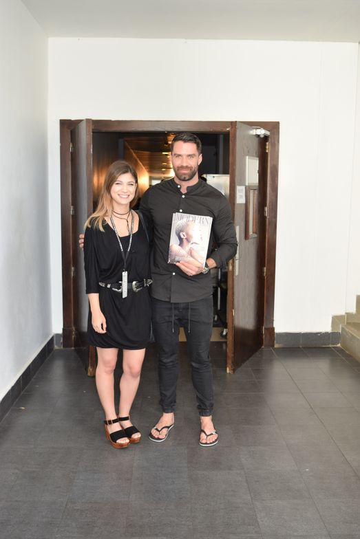 MODERN editor Jamie Newman and Carver, who is holding the November issue of MODERN, with a cover image by Ammon Carver Studio.