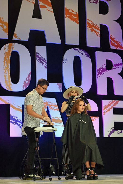 <strong>Larisa Love</strong> (@larisadoll) and <strong>Geraldo Caton</strong> (@hairaldo) on the Hair Color Stage for the <strong>Cosmoprof</strong> LxPxJ presentation.