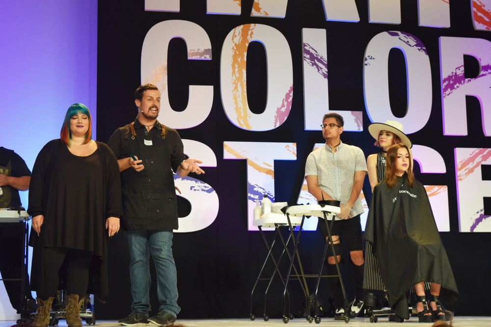 <strong>Phil Ring</strong> (@phildoeshair) and <strong>Larisa Love</strong> (@larisadoll) on the Hair Color Stage for the <strong>Cosmoprof</strong> LxPxJ presentation.