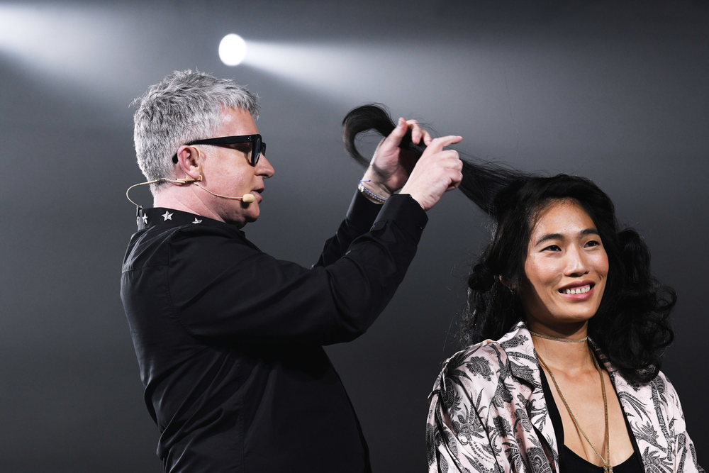 Kevin Murphy demonstrates how to create body without using a curling iron by knotting hair. He says big hair is back on-trend.