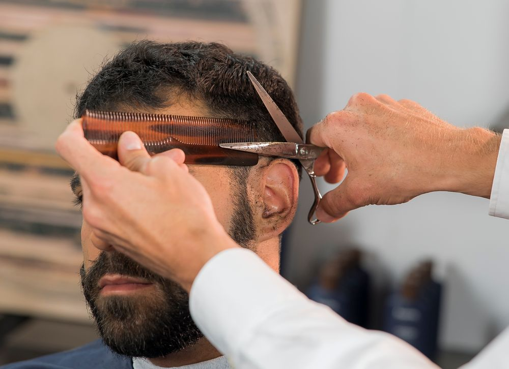 STEP 6: Use the scissor-over-comb technique, connecting sides to top. Repeat the same technique on the other side, blending the sides to the top.