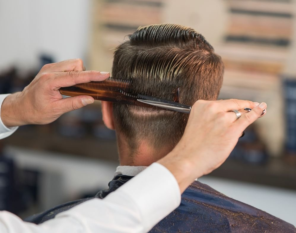 STEP 7: Cut the sides and back with the scissor-over-comb technique.