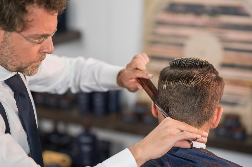STEP 8: Remove the length, create and blend, then detail the perimeter. Connect the nape with the sides moving The Classic Straight Comb horizontally through the hair.