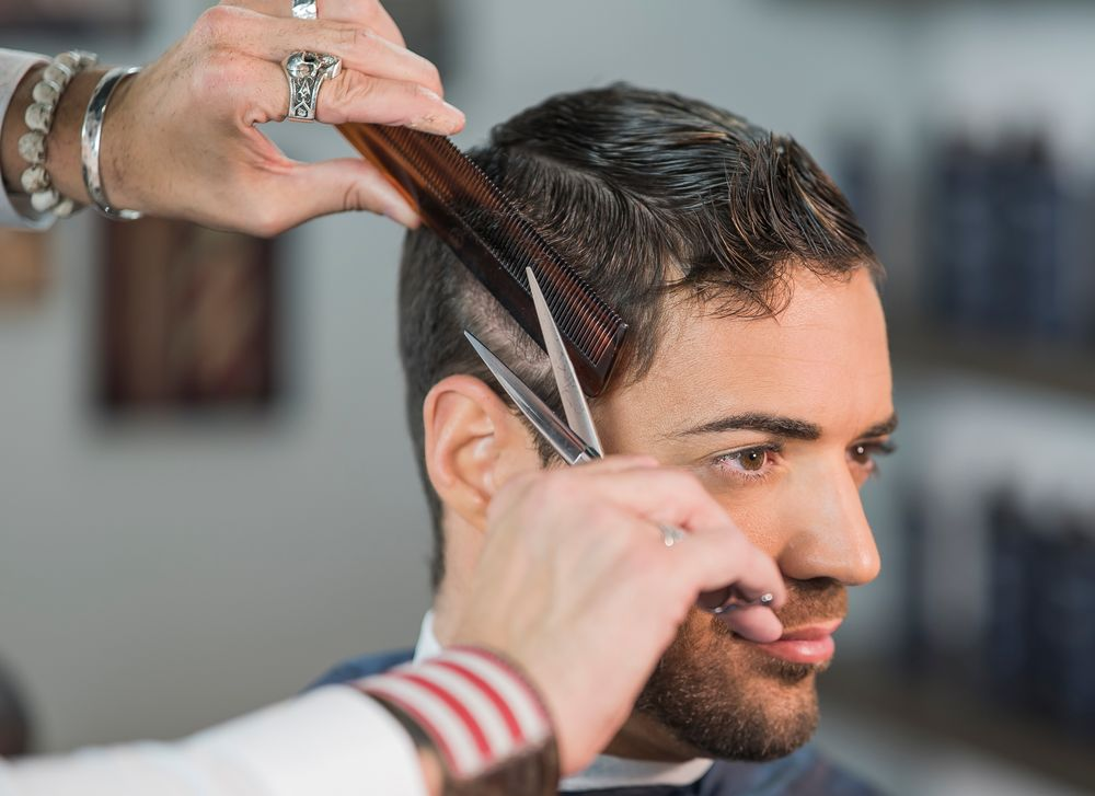 STEP 1: Create a horseshoe parting by using The Esquire Classic Straight Comb to separate the side from the top area, and use the scissor-over-comb technique on the sides, maintaining the cadence (keeping everything in line).
