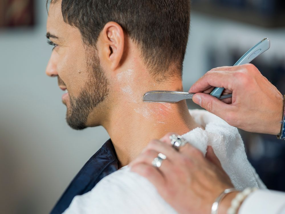 STEP 10: Use a razor to clean up the neckline.