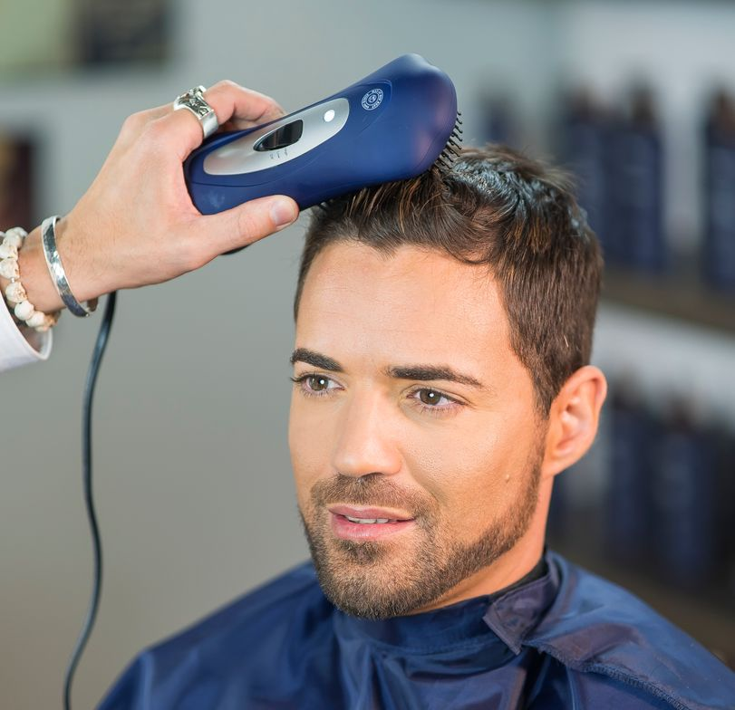STEP 11: Apply The Esquire Thickening Cream throughout the hair and utilize The Esquire Brush Dryer to style.