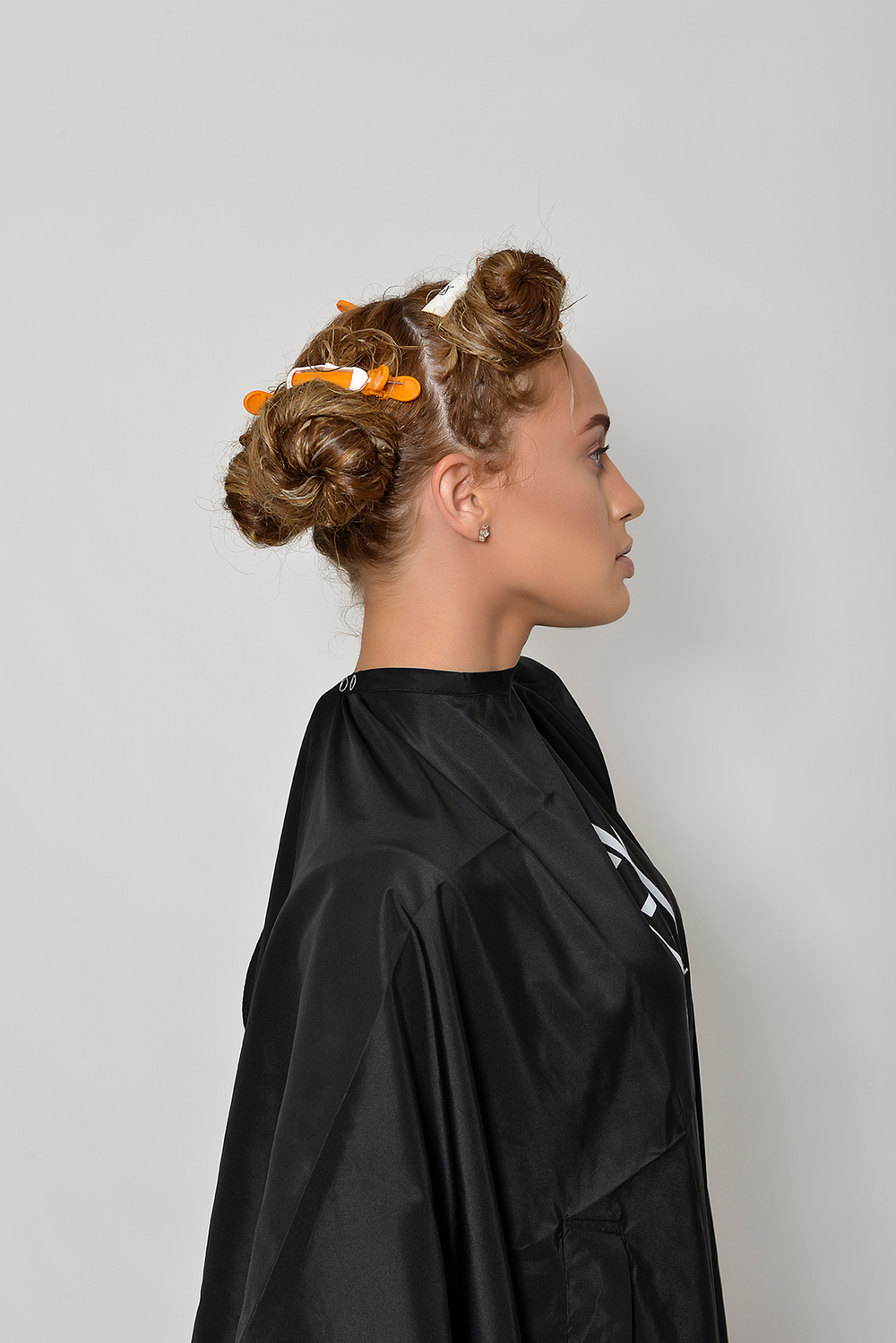 Side: Section the hair into four parts.