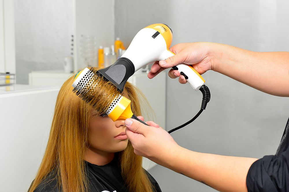 Blow dry hair on high heat and speed along with GKhair Vent Brush to remove access water. Stretch and pull hair in each section while blow drying to achieve straight results section by section.