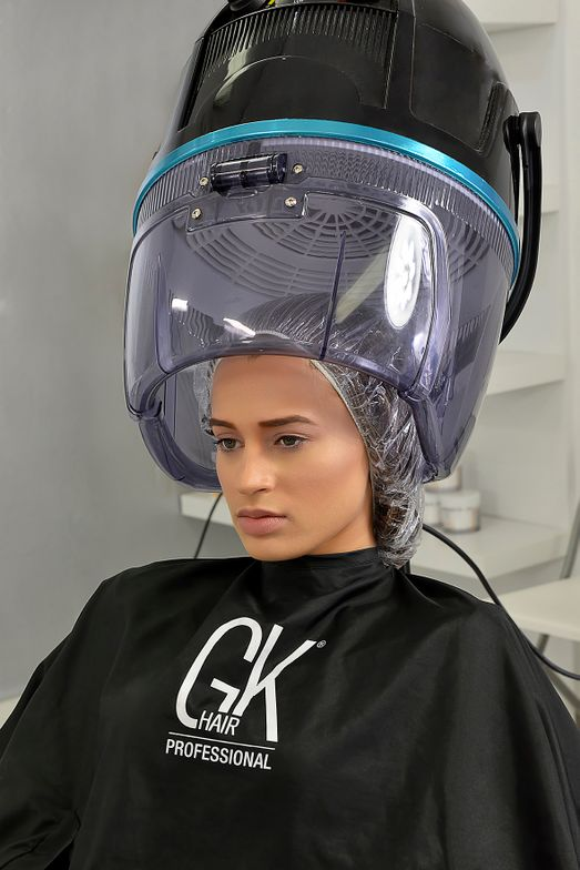 Place a plastic cap on the model. Process the hair under a dryer for 30 minutes.