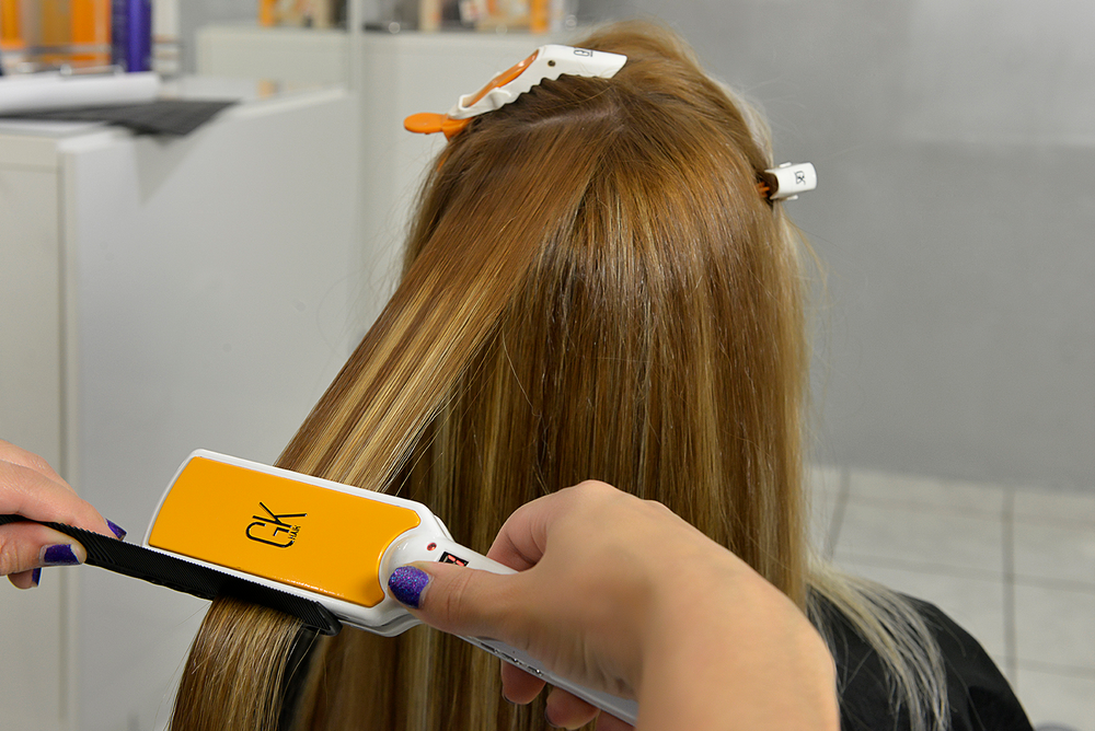 Flatiron the hair to seal the cuticle. Remember to adjust the heat according to the hair type.