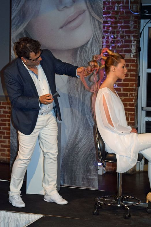 Gareth Palmer styles his model onstage at the Luxurious Minimalism launch party.
