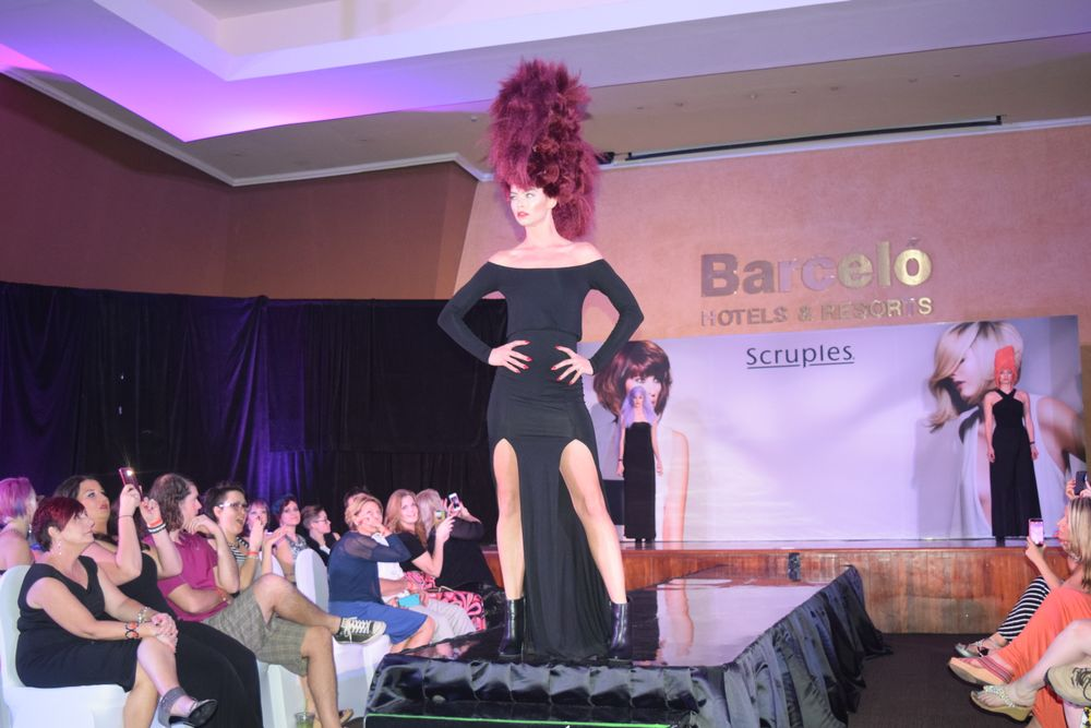 The final look at Sunday night's runway presentation, an oxblood-colored avant garde Mohawk, made a bold statement.