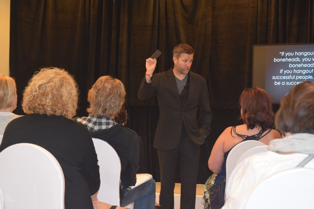 """Chris Venesky, design team member, discusses salon development and growth through leadership and communication skills during his """"$1,000 Cup of Coffee"""" business lecture."""