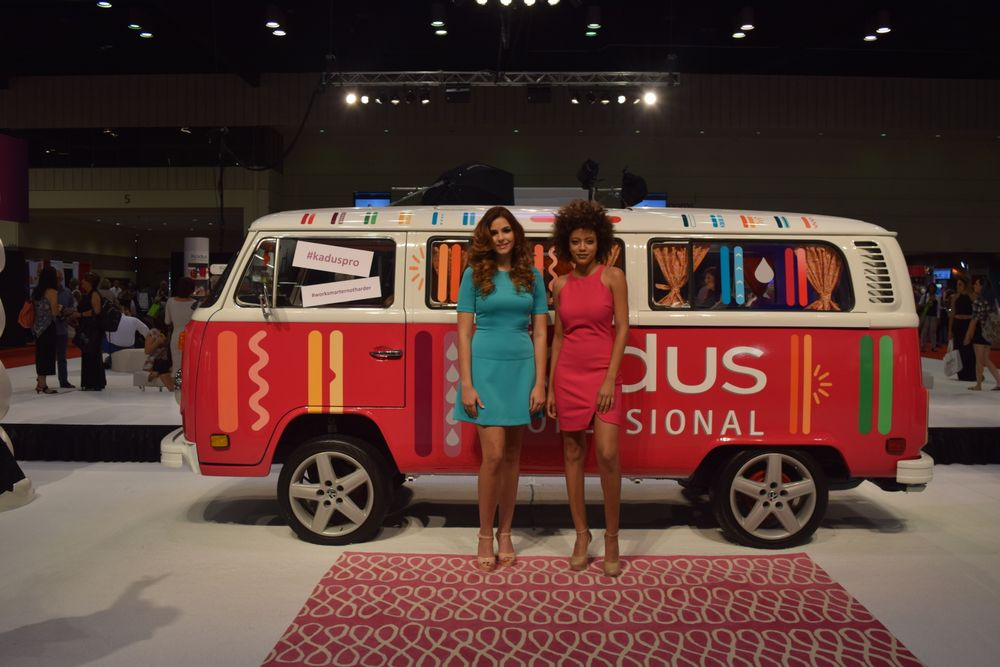 The Kadus Professional booth featured bright punches of color from both models' clothing and props.