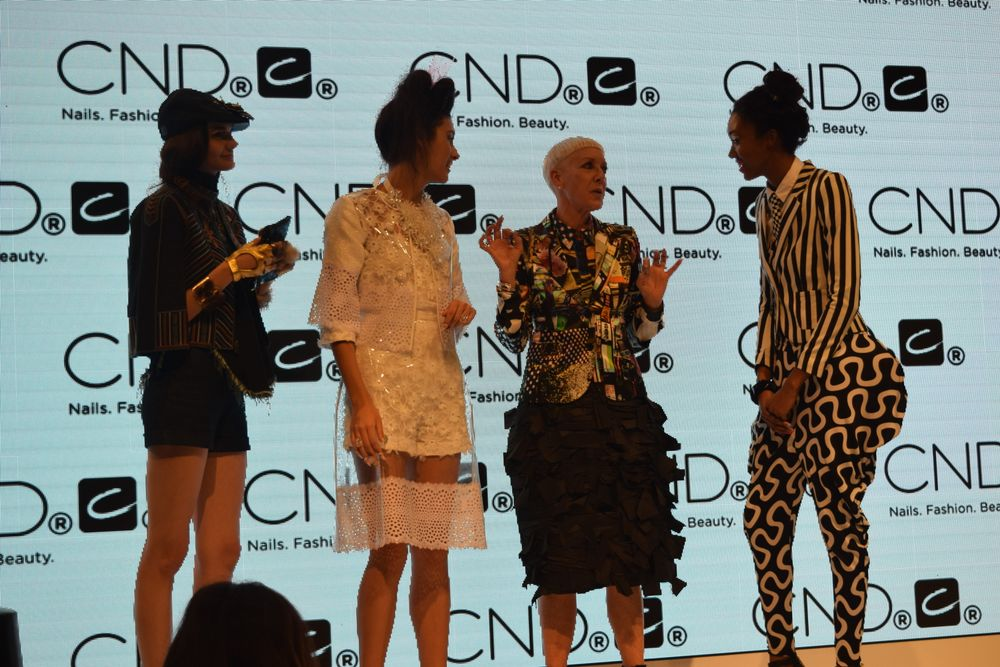 Jan Arnold of CND onstage with models during one of several of the brand's runway presentations throughout the 2-day show.