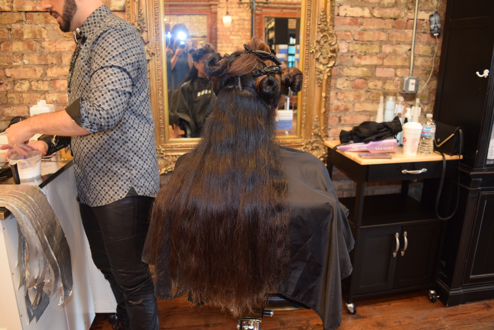 Model's hair before. Dark and long with some existing lightened pieces.