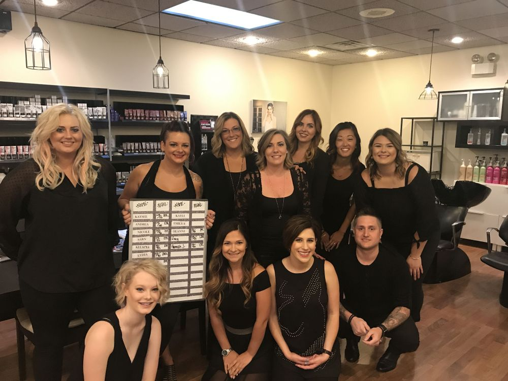 The team from HQ Salon and Spa are energized to hit goals after a dance session.