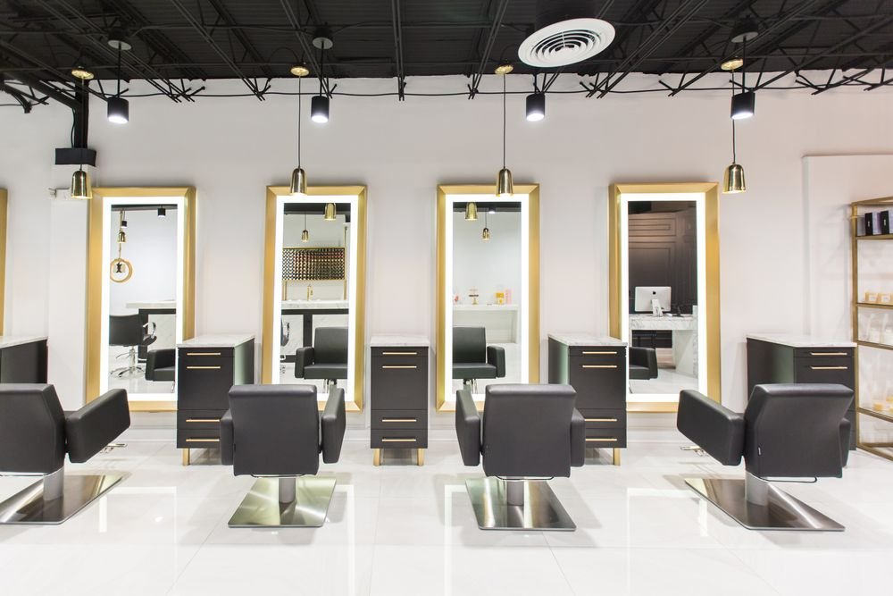 After their appointments, guests are invited to stand before the salon's beauty light so their finished style can be captured for social media.