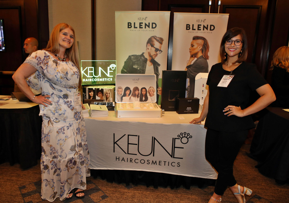The team from Keune ready their tabletop for the networking session.