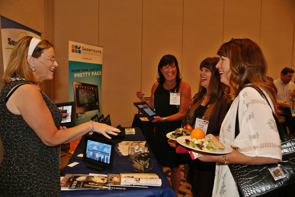 Attendees learn about the Smarter Lifestyle Network at their booth.