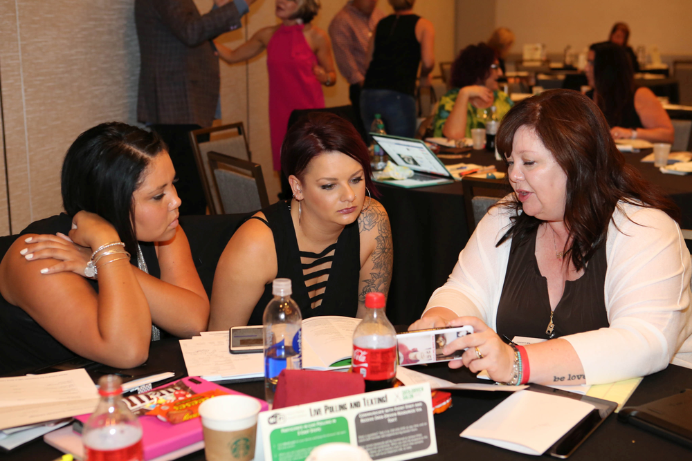 Attendees share data about their salons they learned during the Stack Up exercise.
