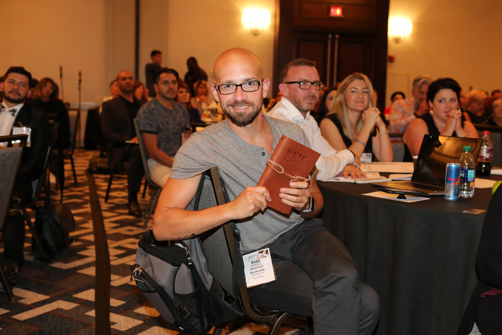 Ginger Bay's Ryan Campbell is gifted with one of Mawdesley's leather-bound journals.