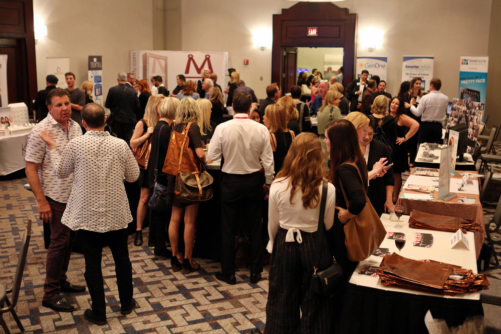 Attendees network with vendors during the cocktail hour.