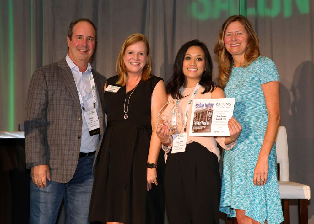 <p>Salon Today&#39;s Stacey Soble presents the 2018 Salons of the Year award to Scott Missad and the team from Gene Juarez Salon and Spa for their Bellevue, Washington, location.</p>