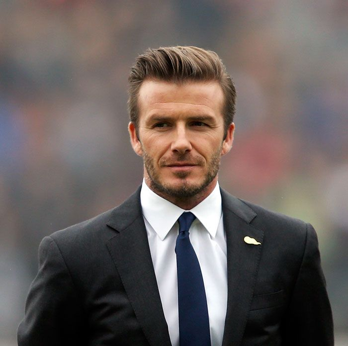 British football player David Beckham attends a meeting with the Youth Football Team at Hankou Literary and Sports Center in China.