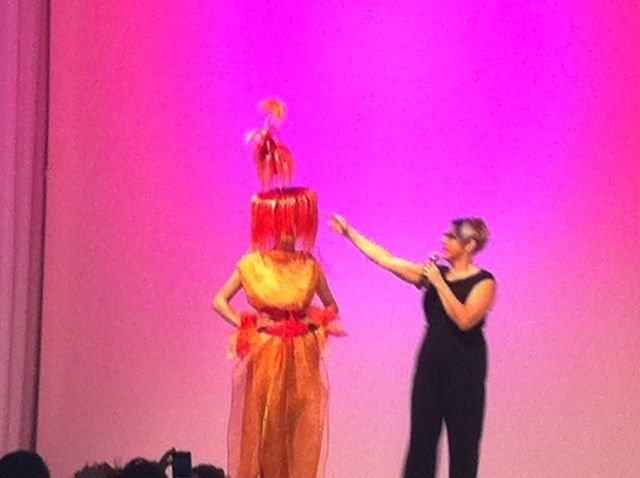 Global Artistic Director Dee Fortier shows off a model inspired by fireworks.