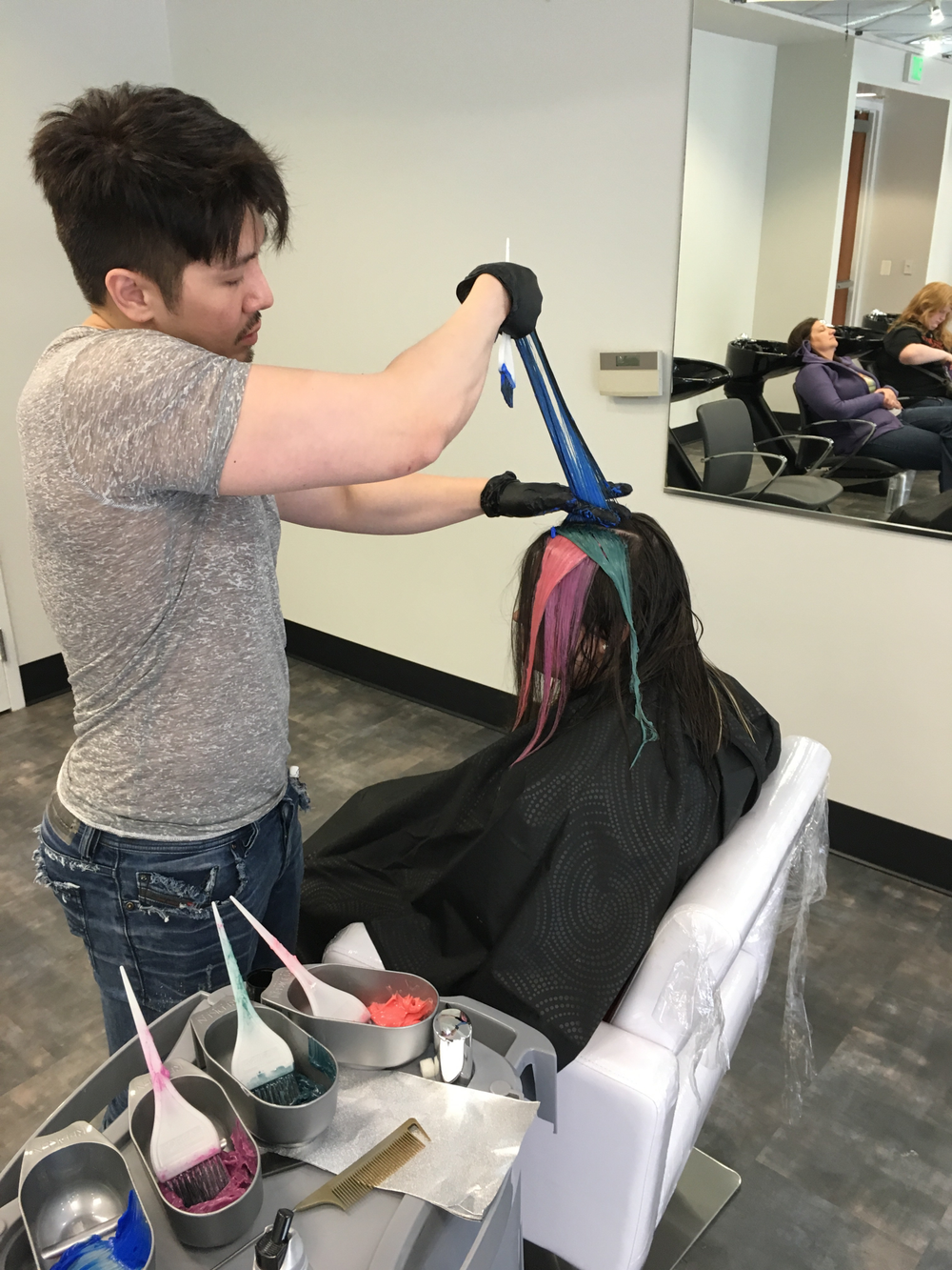 Guy Tang coloring hair.