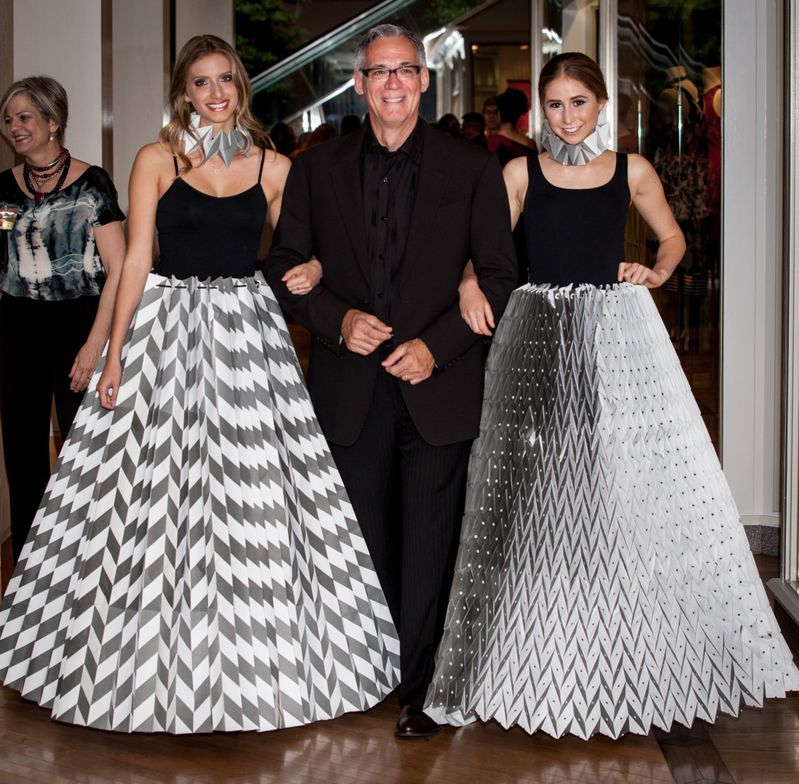 Dominic Bertani escorts Jessica Cohen and Julie Devinsky, who were wearing skirts designed by Jamie Presson-Wells.