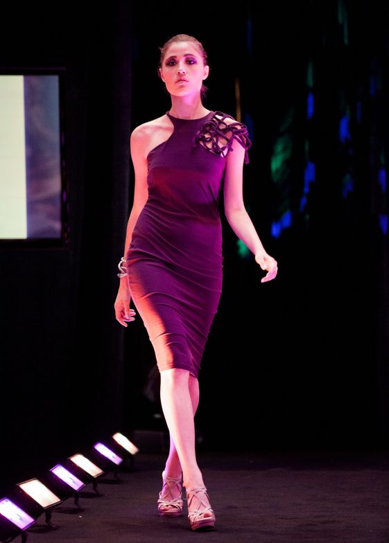 Another student's fashion work debuts on the runway.