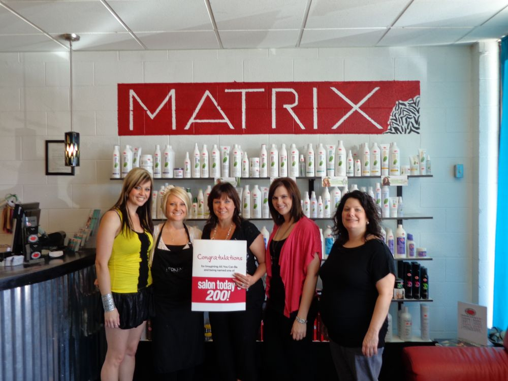 The staff at Dr. Flys Salon, owned by Robyn Paul, in Joplin, Missouri, with their giant Matrix card.