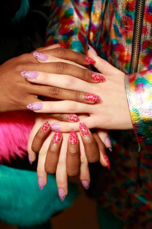 """Inspired by the vibrant neon shades found in Jeremy Scott's Fall/Winter 2018 collection, Miss Pop for Essie channeled the designer's raver muse by creating a """"cool, techno animal print"""" on nails. Using three of Essie's highly pigmented polishes, the pro produced a playful pattern that's as easy to achieve at home as it is bold and bright. """"Try a half macaroni shape or a single dot of color to fill any empty space,"""" Miss Pop said."""