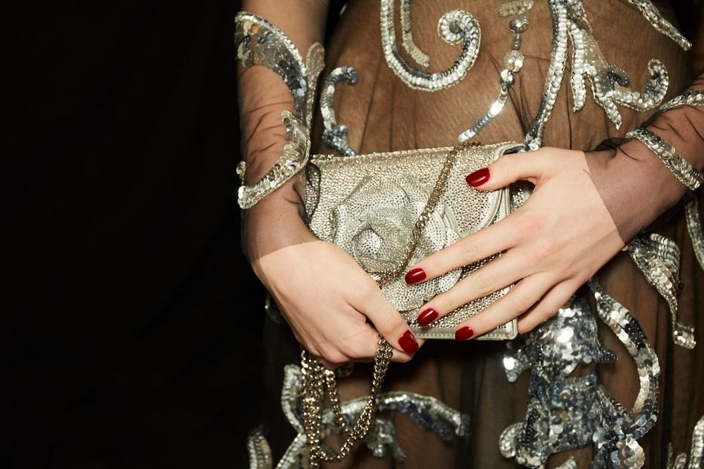 """Inspired by the lush floral and Elizabethan prints in Oscar de la Renta's Fall/Winter 2018 collection, Kandalec created a bold-yet-sophisticated burgandy manicure. For a clean cuticle line, erase smudges with an orange wood stick dipped in acetone. """"The wood is porouse so you don't need fuzzy cotton, which can stick to polish,"""" Kandalec said."""