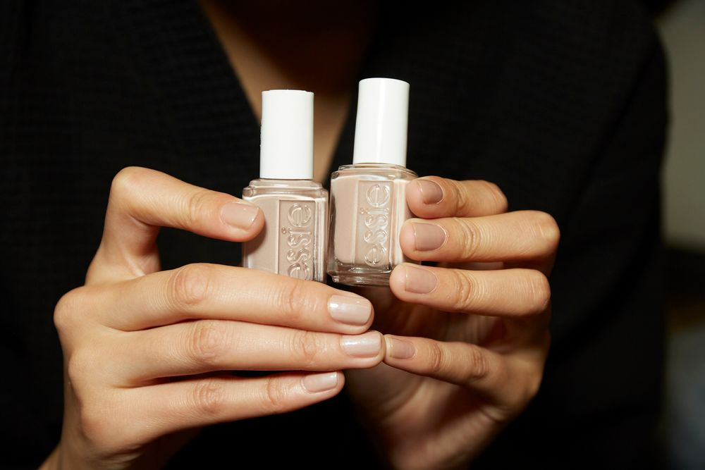 """With the """"modern CEO"""" serving as muse for Alexander Wang's Fall/Winter 2017 show, Remark for played off the chrome accents in the collection by lending the nail a sublte """"strobing effect"""" that mirrored the shine on cheekbones. The result is a steely, nude, manicure loaded with shine. """"Anything but traditional- this is a modern empowered woman,"""" said Remark. """"She's rewriting the rules of what it means to look and behave like a CEO."""""""